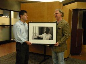Ken Kollman, Director of the U-M International Institute, accepts a photo from D