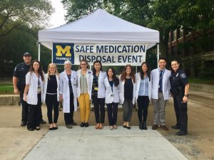 Pharmacy students collecting medication