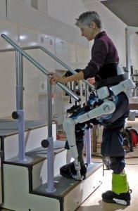 Photo Caption: Jennifer Robertson in a HAL exoskeleton climbing a staircase at Cyber Studio, Tsukuba, Japan (November 2015).