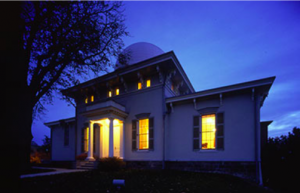 Visitors arrive at the Detroit Observatory with a quarter moon above