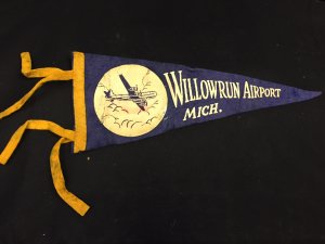 Photograph of Willow Run banner, courtesy of Yankee Air Museum. High resolution version available upon request.