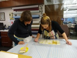Clements Conservator and Student Intern Working Together