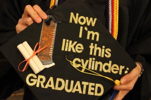 "mortar board decorated ""now I am like this cylinder --graduated"""