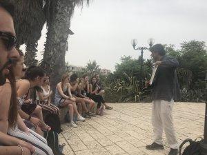 Professor teaching students abroad