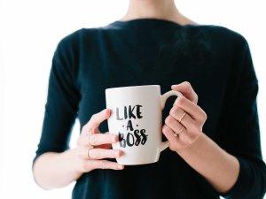 "woman holding coffee mug that says ""Like a Boss"""