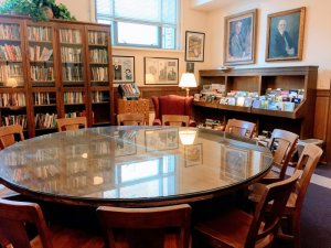 Hopwood Room with round table and bookcases