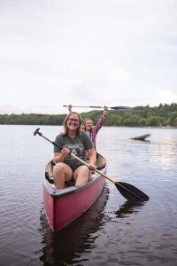 Students enjoy a canoe ride on Douglas Lake at the U-M Biological Station.