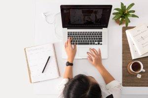 Individual working on laptop