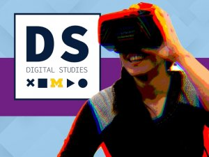 Female smiling while using VR, facing the Digital Studies logo