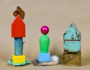 Two House Totems surrounding small Totem by Candace Compton Pappas, photograph by the artist.