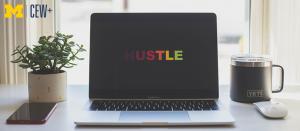 laptop that says hustle