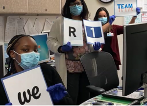 R1 Employees holding signs
