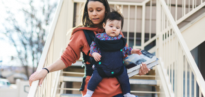Woman walking down stairs with child and textbooks