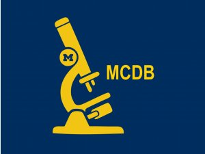 Yellow MCDB initials and Microscope drawing on blue