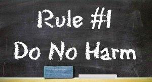 """Words written on a blackboard, """"RULE #1 DO NO HARM"""""""