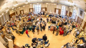 Dealers and shoppers fill the Michigan Union ballroom during a past book fair.