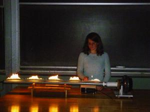 Professor Aidala demonstrating sound waves.