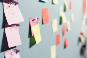 wall full of colorful sticky notes that have been tacked on during a brainstorming session