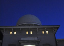 People entering the Detroit Observatory at night