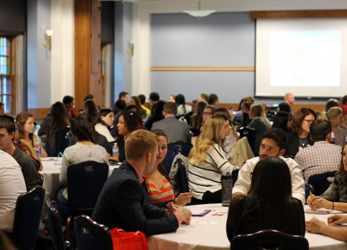 Photo of students attending an informal networking chat with alumni and recruiters