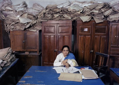 Office worker in India by Jan Banning
