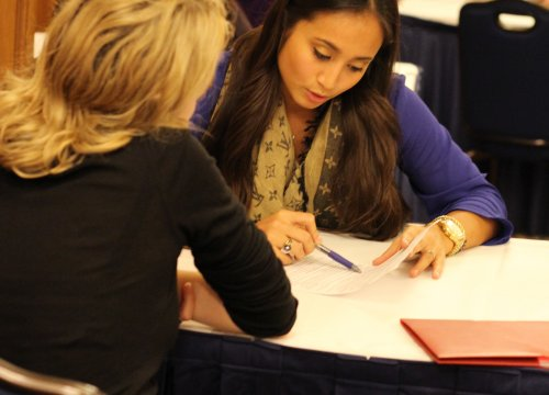 Employer helping a student with their resume during an Employer Resume Review event